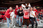Wisconsin Badgers mascot Bucky Badger poses with fans during an NCAA college women's basketball game against the Duke Blue Devils during the ACC/Big Ten Challenge at the Kohl Center in Madison, Wisconsin on December 2, 2010. Duke won 59-51. (Photo by David Stluka)