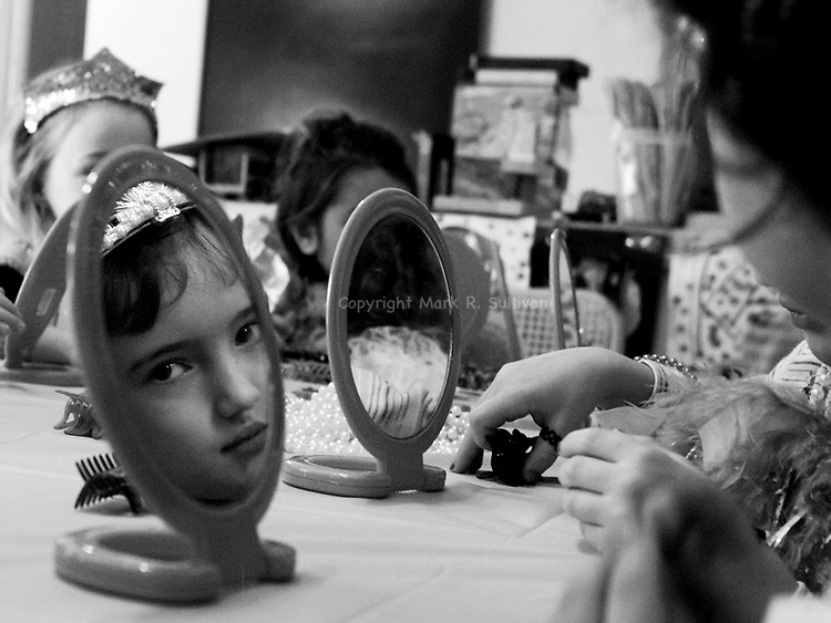 6 yr old birthday girl Katie Laskey of Montgomery had a Little Princess Tea Party held for her at her home.Here one of the guests reflected in a make up mirror during make up time.