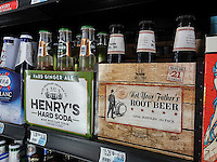 Six-packs of hard soda seen in a convenience store cooler in New York on Tuesday, July 26, 2016. Appealing to Generation Xers and Millennials, the sodas evoke drinking soda pop before it was considered unhealthy, but contains the kick of alcohol. In 2015 hard soda sales totaled around $116 million. (© Richard B. Levine)