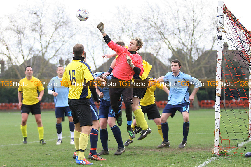 Manor House (Blue) v Sungate (Yellow) - Essex Sunday Corinthian League Football -Barking Park 18/03/12 - MANDATORY CREDIT: George Phillipou/TGSPHOTO - Self billing applies where appropriate - 0845 094 6026 - contact@tgsphoto.co.uk - NO UNPAID USE.