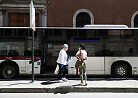 People wait for a bus in central Rome on May 4, 2020 as Italy starts to ease its lockdown, during the countrys lockdown aimed at curbing the spread of the COVID-19 infection, caused by the novel coronavirus.<br /> UPDATE IMAGES PRESS/Isabella Bonotto