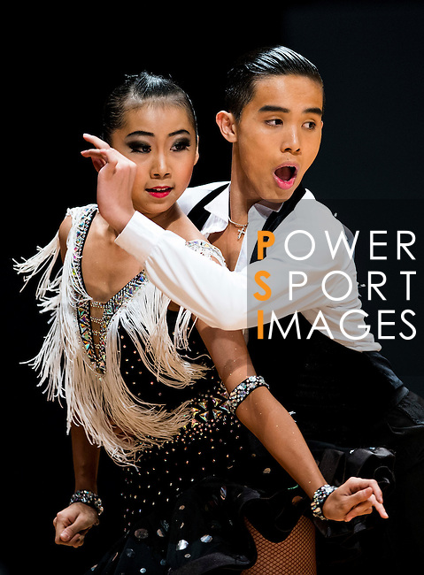 Tin-Long Che and Ka-Weng Lo of Macau during the Hong Kong Open Latin - Age 15 or below on the Day 2 of the WDSF GrandSlam Hong Kong 2014 on June 01, 2014 at the Queen Elizabeth Stadium Arena in Hong Kong, China. Photo by AItor Alcalde / Power Sport Images