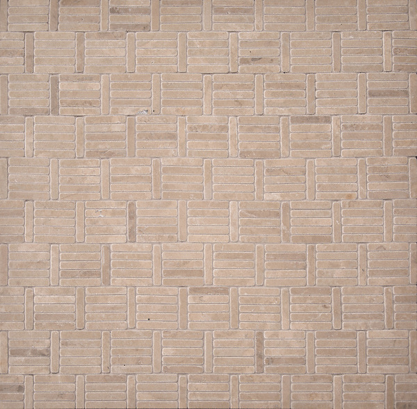 Wicker, a hand-cut tumbled mosaic, shown in Lagos Gold, is part of the Tissé® collection for New Ravenna.