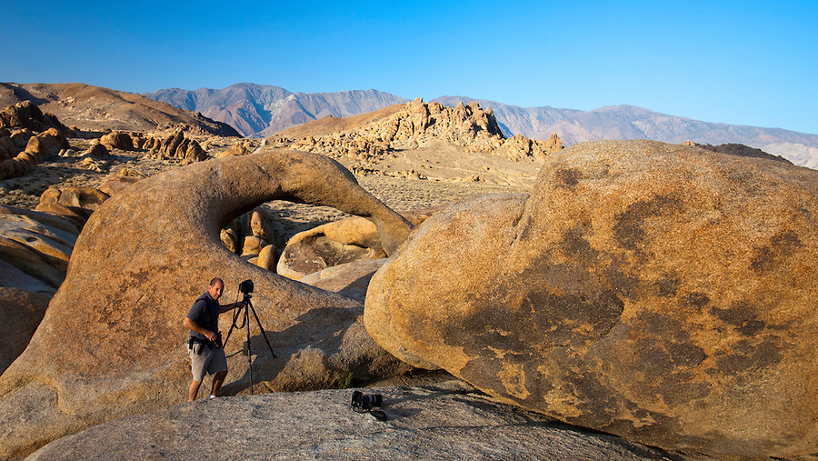 "That's me, Andrew Shurtleff, shooting the famous little arch at Alabama Hills. The Alabama Hills are a ""range of hills"" and rock formations near the eastern slope of the Sierra Nevada Mountains in the Owens Valley, west of Lone Pine in Inyo County, California. The Alabama Hills, managed by the U.S. Bureau of Land Management as the BLM Alabama Hills Recreation Area, are a protected habitat and for public enjoyment. Photo/Andrew Shurtleff"