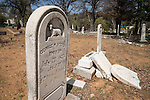 Headstones in the 19th century and historic Coulterville Cemetery in California's Mother Lode Gold Country..George Stevens