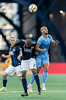 FOXBOROUGH, MA - SEPTEMBER 29: Andrew Farrell #2 of New England Revolution and Heber #9 of New York City FC battle for head ball during a game between New York City FC and New England Revolution at Gillette Stadium on September 29, 2019 in Foxborough, Massachusetts.