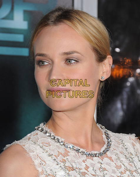 "DIANE KRUGER .Premiere of ""Unknown"" held at The Regency Village Theatre in Westwood, California, USA..February 16th, 2011.headshot portrait white lace silver beads beaded embellished jewel encrusted make-up beauty     .CAP/RKE/DVS.©DVS/RockinExposures/Capital Pictures."