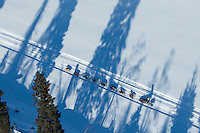 A team runs through tree shadows on the trail along the Tanana river between Fairbanks and Nenana during the 2017 Iditarod on Monday March 6, 2017.<br /> <br /> Photo by Jeff Schultz/SchultzPhoto.com  (C) 2017  ALL RIGHTS RESVERVED