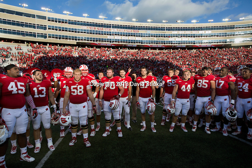 "Wisconsin Badgers team sings ""On Wisconsin"" after an NCAA Big Ten Conference football game against the Purdue Boilermakers on Saturday, September 21, 2013, in Madison, Wis. The Badgers won 41-10. (Photo by David Stluka)"