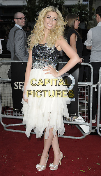 STACEY SOLOMON .Attending the 'Sex And The City 2' European Film Premiere at the Odeon, Leicester Square, London, England, UK, May 27th, 2010 .arrivals full length hand on hip white dress cream black silver beaded tiered tulle layered bows peep toe shoes.CAP/CAN.©Can Nguyen/Capital Pictures.