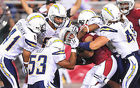Aug. 22, 2009; Glendale, AZ, USA; Arizona Cardinals running back (31) Jason Wright is tackled by several San Diego Chargers defenders during a preseason game at University of Phoenix Stadium. Mandatory Credit: Mark J. Rebilas-