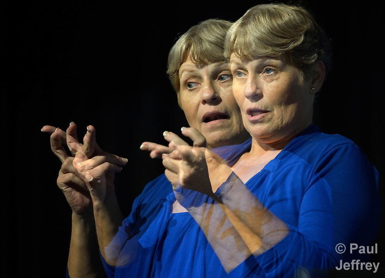 Betty Ostrom provides American Sign Language interpretation at the 2012 United Methodist General Conference in Tampa, Florida. Ostrom is a member of Pine Castle United Methodist Church in Orlando.This image is a double exposure.