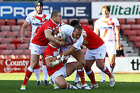 PICTURE BY ALEX WHITEHEAD/SWPIX.COM - Rugby League - Autumn International Series - Wales vs England - Glyndwr University Racecourse Stadium, Wrexham, Wales - 27/10/12 - England's Lee Mossop is tackled by Wales' defence.