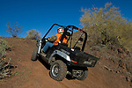 Hunter climbing hill in Prowler UTV