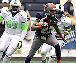 "SIOUX FALLS, SD - FEBRUARY 21:  Troy Harrison #22 from the Sioux Falls Storm breaks loose past Jervonte Jackson #99 and Cornelius ""Pig"" Brown #13 from the Nebraska Danger in the first quarter of their game Friday night at the Sioux Falls Arena. (Photo by Dave Eggen/Inertia)"