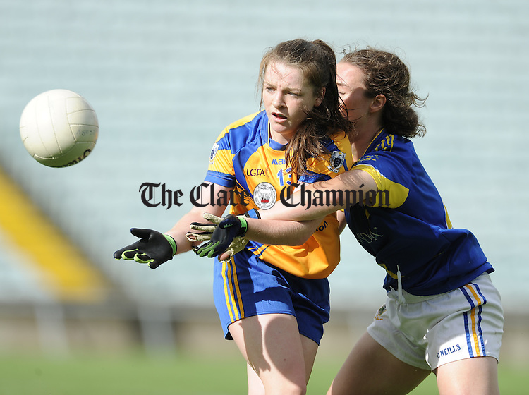 Ciara Hickey of Clare in action against Brid Condon of Tipperary during their Intermediate All-Ireland semi final at The Gaelic Grounds. Photograph by John Kelly.
