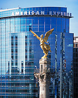 aerial photograph of the El Angel Independence monument at the La Reforma avenue in Mexico City with the American Express building in the background