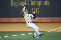 Wake Forest Demon Deacons right fielder Michael Ludowig (22) catches a fly ball in foul territory during the game against the Virginia Cavaliers at David F. Couch Ballpark on May 19, 2018 in  Winston-Salem, North Carolina.  The Demon Deacons defeated the Cavaliers 18-12.  (Brian Westerholt/Four Seam Images)