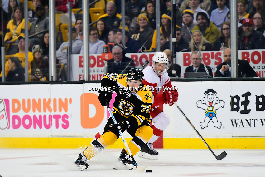 Tuesday, January 24, 2017: Boston Bruins center Frank Vatrano (72) plays the puck in the neutral zone during the National Hockey League game between the Detroit Red Wings and the Boston Bruins held at TD Garden, in Boston, Mass. Boston defeats Detroit 4-3 in overtime. Eric Canha/CSM