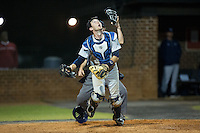 Catawba Indians catcher Zach Almond (23) tracks a pop fly during the game against the Belmont Abbey Crusaders at Abbey Yard on February 7, 2017 in Belmont, North Carolina.  The Crusaders defeated the Indians 12-9.  (Brian Westerholt/Four Seam Images)