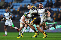 Nathan Hughes of Wasps takes on the Bath Rugby defence. European Rugby Champions Cup match, between Wasps and Bath Rugby on December 13, 2015 at the Ricoh Arena in Coventry, England. Photo by: Patrick Khachfe / Onside Images