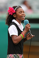 Jupiter Hammerheads have Little Miss Florida Tamara Hoffenden sing the national anthem before a game against the Bradenton Marauders at Roger Dean Stadium on April 30, 2012 in Jupiter, Florida.  Bradenton defeated Jupiter 8-0.  (Mike Janes/Four Seam Images)