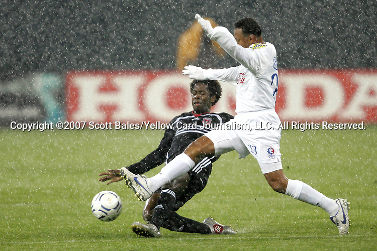01 March 2007: DC United's Clyde Simms (left) tackles the ball away from Olimpia's Sergio Mendoza (23). DC United defeated CD Olimpia of Honduras 3-2 at RFK Stadium in Washington DC in the second leg of a CONCACAF Champions Cup quarterfinal competition.  DC United advanced by an aggregate score of 7-3.