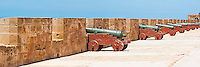 Panoramic photo of old canons on the ramparts (North Bastion), Essaouira, formerly Mogador, UNESCO World Heritage Site, Morocco, Africa. This panoramic photo shows the North Bastion, a section of the ramparts that is an incredible 300m long and lined with old canons.