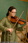 Middle School grade 8 music education girl playing violin vertical