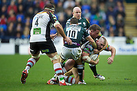 Joe Marler of Harlequins (right) is brought down to earth by Ian Humphreys and Max Lahiff of London Irish  during the Aviva Premiership match between London Irish and Harlequins at the Madejski Stadium on Sunday 28th October 2012 (Photo by Rob Munro)