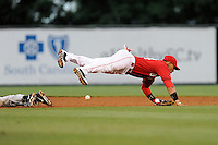 Second baseman Yoan Moncada (24) of the Greenville Drive leaps for an errant throw in a game against the Augusta GreenJackets on Thursday, June 11, 2015, at Fluor Field at the West End in Greenville, South Carolina. The Cuban-born 19-year-old Red Sox signee has been ranked the No. 1 international prospect in baseball by Baseball America. Greenville won, 10-1. (Tom Priddy/Four Seam Images)