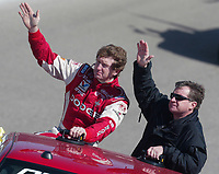 Bill Elliott(left) and Joe Nemecheck wave to fans prior to start of  the Pop Secret 400 NASCAR Winston Cup race at Rockingham, NC on Sunday, November 9, 2003. (Photo by Brian Cleary)