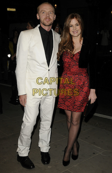 SIMON PEGG & ISLA FISHER .Attends the 'Burke and Hare' World Premiere at The Chelsea Cinema, Kings Road, Chelsea, London, England, UK, 25th October 2010..full length suit black shirt tie shoes white Red dress patterned  print bolero jacket cropped crop shoes tights .CAP/CAN.©Can Nguyen/Capital Pictures.