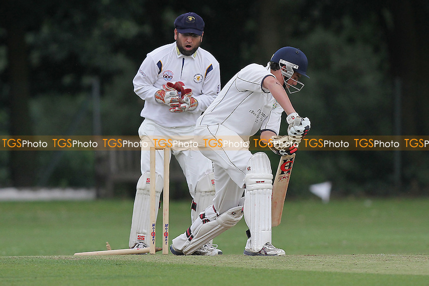 J Ellis-Grewal of Wanstead is bowled out - Wanstead CC (batting) vs Ardleigh Green CC - Essex Cricket League - 06/08/11 - MANDATORY CREDIT: Gavin Ellis/TGSPHOTO - Self billing applies where appropriate - 0845 094 6026 - contact@tgsphoto.co.uk - NO UNPAID USE.