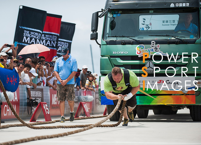 HAINAN ISLAND, CHINA - AUGUST 23:  Johannes Arsjo of Sweden competes at the Truck Pull event during the World's Strongest Man competition at Serenity Marina on August 23, 2013 in Hainan Island, China.  Photo by Victor Fraile