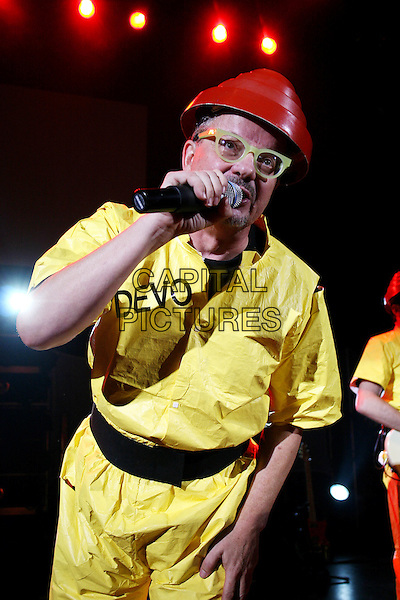 DEVO.Live in concert at Shepherds Bush Empire, London, England..June 26th, 2007 .stage concert gig performance music singing yellow jumpsuit red hat plastic lego glasses half length.CAP/MAR.© Martin Harris/Capital Pictures.