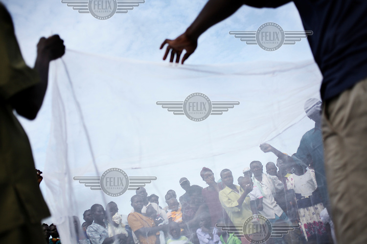 A free mosquito net distribution near Masindi.
