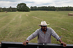 May 22, 2010. Baskerville, Virginia.. John Boyd, Jr. on land that he and his father lease over 20 miles from their family farm to run cattle on, as they are unable to find land closer to home.. Dr. John Boyd, Jr., a Virginia farmer, has lobbied the White House and Congress for the better part of two decades on behalf of black farmers. .A $1.25 billion settlement he helped to negotiate in February for the federal government to compensate black farmers has become ensnared in Washington. .Meanwhile, many elderly farmers who stand to benefit are dying before they can seek restitution..Their case, known as the black farmers settlement, and commonly referred to as Pigford II, is the second phase of a federal lawsuit settled in 1999. It covers more than 80,000 farmers who claim they were denied critical aid comparable to what white farmers received from the Department of Agriculture between 1981 and 1996 because of the color of their skin..Congress reopened the case in 2008, and set aside $100 million to address the late claims. President Barack Obama, who co-sponsored the 2008 measure when he was in the Senate, created a $1.15 billion line item in his budget for the 2010 fiscal year to cover the new class of litigants..The money was less than half of the $2.5 billion the farmers had fought for, but the administration's promise of a quick resolution prompted them to accept the deal.  .