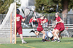 Los Angeles, CA 02/08/13 - Rachel Vallarelli  (Umass #26), Morgan Walker  (Umass #12) and other Umass and Northwestern players in action during the Northwestern vs UMass NCAA Women's Lacrosse game at USC's McAlister Field.