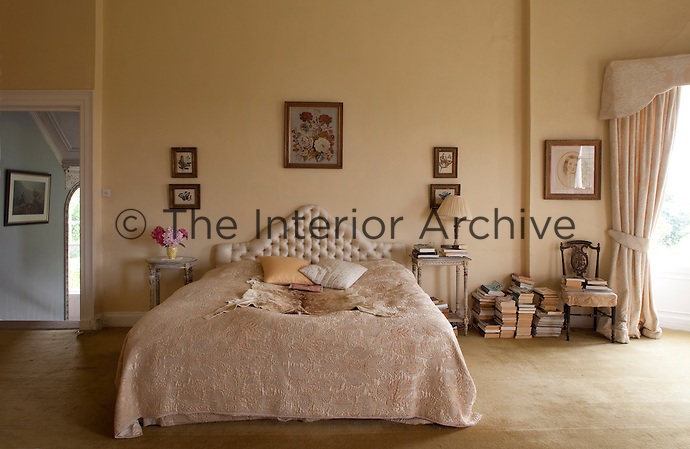 The double bed in the master bedroom has a buttoned headboard with a cover to match the curtains