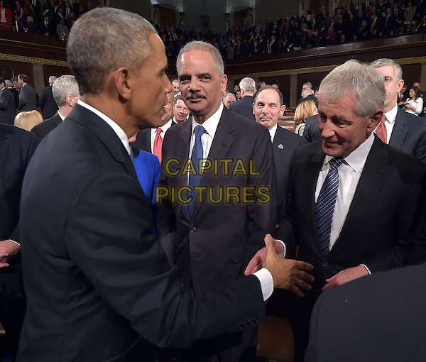 US President Barack Obama shakes hands with US Secreatry of Defense Chuck Hagel (R) as Attorney General Eric Holder (C) watches after Obama delivered the State of The Union address on January 20, 2015, at the US Capitol in Washington, DC.  <br /> CAP/MPI/MAN<br /> &copy;MAN/MPI/Capital Pictures