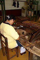 Woman rolling cigars in the Tabacalera Alberto Turrent  cigar factory near San Andres Tuxtla Veracruz, Mexico              .