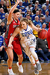 BROOKINGS, SD - JANUARY 25: Madison Guebert #11 from South Dakota State University drives past Madison McKeever	 #23 from the University of South Dakota during their game Thursday night at Frost Arena in Brookings. (Photo by Dave Eggen/Inertia)