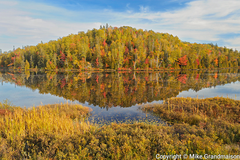 Reflection of autumn colors in northern lake<br />