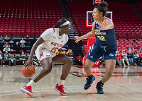 COLLEGE PARK, MD - NOVEMBER 20: Ashley Owusu #15 of Maryland dribbles past Essence Brown #32 of George Washington during a game between George Washington University and University of Maryland at Xfinity Center on November 20, 2019 in College Park, Maryland.