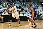 21 December 2013: North Carolina's Brittany Rountree (11) and High Point's Lindsay Pickett (right). The University of North Carolina Tar Heels played the High Point University Panthers in an NCAA Division I women's basketball game at Carmichael Arena in Chapel Hill, North Carolina. UNC won the game 103-71.