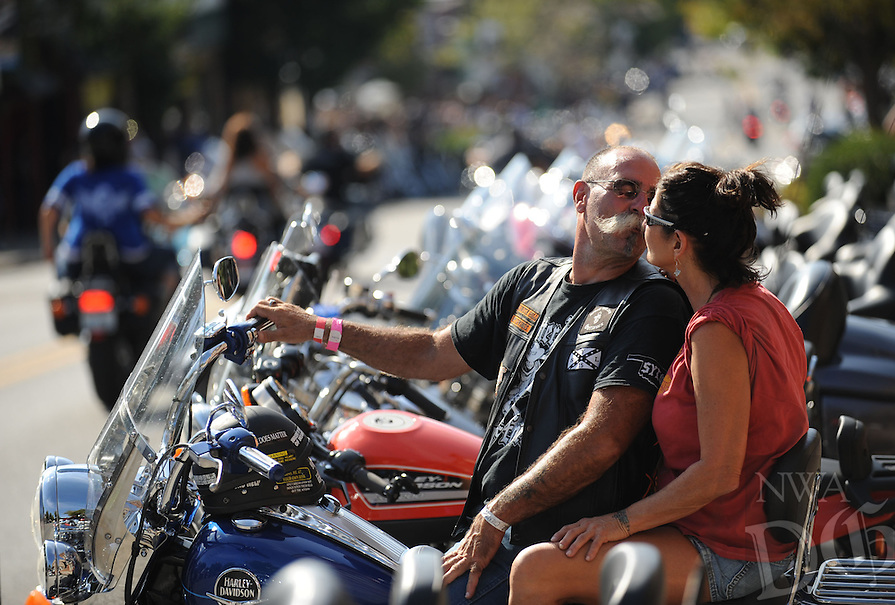 STAFF PHOTO ANDY SHUPE - Bill Lemser and Kandy Kuykendall of Amity kiss before heading out on their motorcycle Thursday, Sept. 25, 2014, at the 15th annual Bikes, Blues & BBQ in Fayetteville.