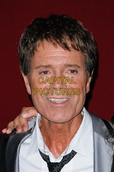 Sir Cliff Richard.World Hunger Day Concert - photocall held at the Royal Albert Hall, London, England..May 28th, 2012.headshot portrait white shirt black tie silk satin grey gray.CAP/CJ.©Chris Joseph/Capital Pictures.