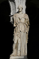 View from the front of a Roman statue of Minerva, Central Patio, Casa de Pilatos (Pilate's House), Seville, Spain, pictured on December 30, 2006, in the afternoon. Pilate's House, late 15th century, was built by the Enriquez and Ribera families During the 16th century these families, who had a strong relationship with Italy,  introduced the Renaissance style to Seville. In the palace is the sculpture collection of the Duke of Alcala  who brought back many Classical pieces from Italy and adapted the palace and gardens to exhibiting them in Renaissance style. The buildings were further modified according to Romantic taste in the 19th century and now present a combination of Mudejar-Gothic, Renaissance and Romantic styles. Today the Casa de Pilatos belongs to the Fundacion Casa Ducal de Medicaneli and is the residence of the Dukes of Medicaneli. Picture by Manuel Cohen.