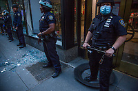 NEW YORK, NEW YORK - JUNE 1: Police officers Stand Guard outside the Nintendo store damaged by protesters on June 1, 2020 in New York. The protests spread across the country in at least 30 cities across the United States, over the death of unarmed black man George Floyd at the hands of a police officer, this is the latest death in a series of police deaths of black Americans. Today is the first night of a curfew in New York City (Photo by Pablo Monsalve / VIEWpress via Getty Images)